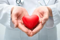 doctor holding a heart shape staff
